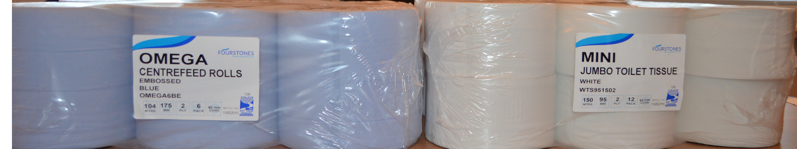 Optional labels on a blue centrefeed and mini jumbo toilet roll product.